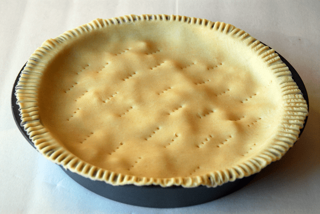 filling in pan covered with pie crust