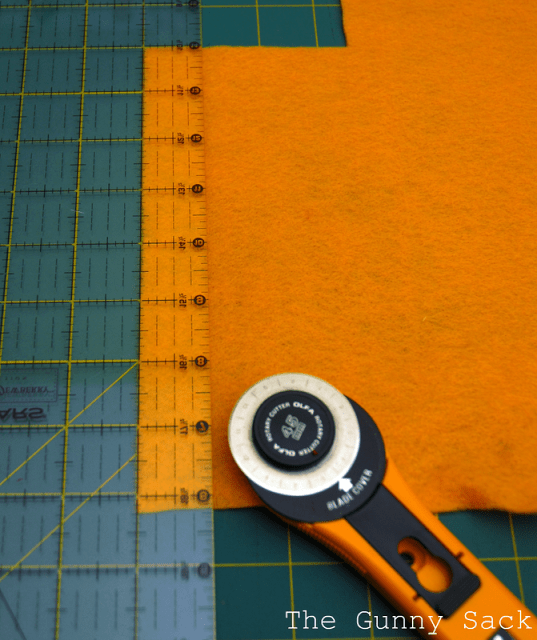 cutting out squares of felt