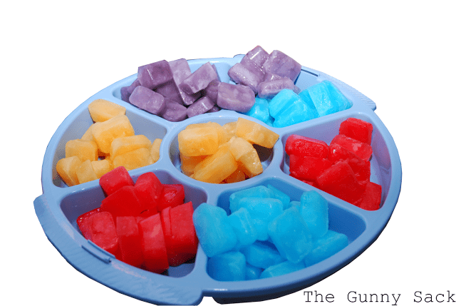 Kool Aid ice cubes in a blue tray