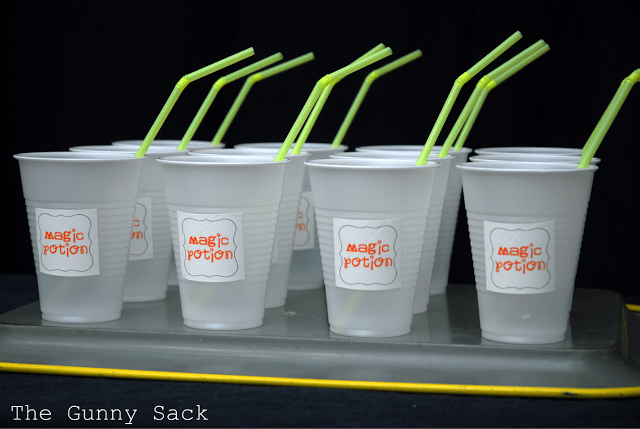 plastic cups with magic potion labels and straws