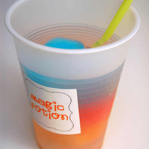 magic potion drink in plastic cup
