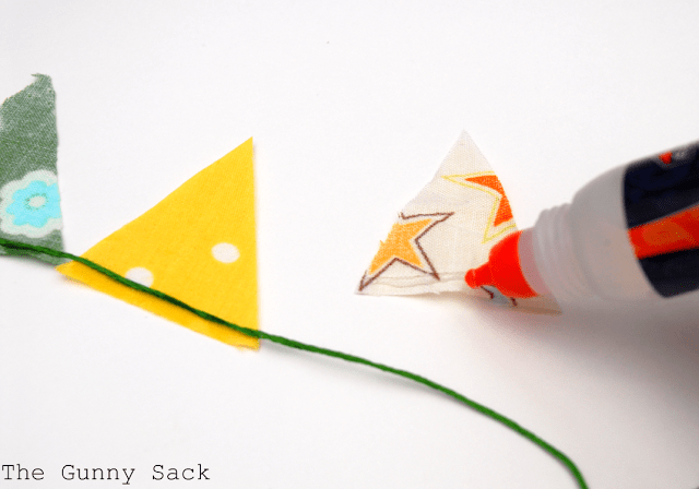 glue fabric triangles on string