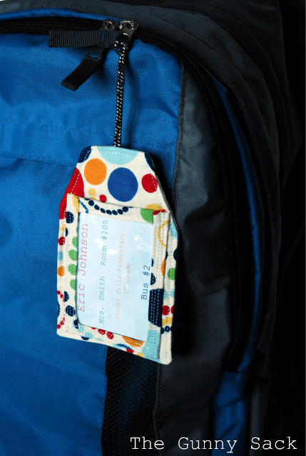 polka dot backpack tag on a blue backpack