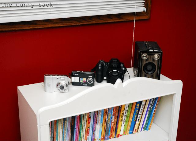 cameras on a bookshelf