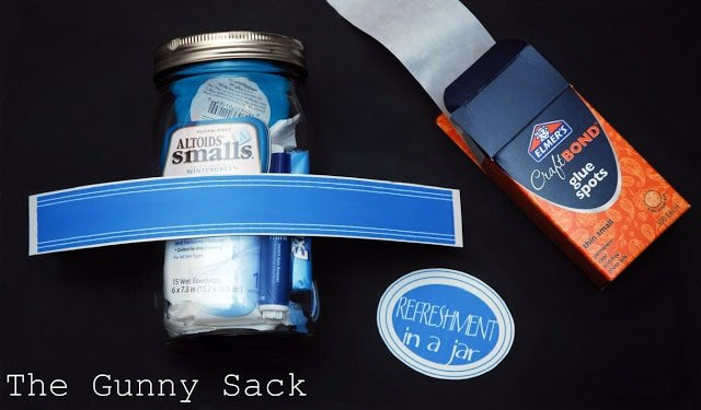 gluing label strip on jar