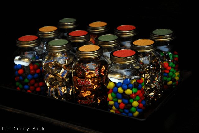 mason jars filled with candy on tray