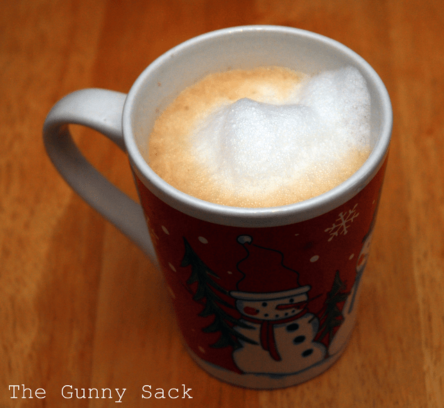 frothy milk in cup