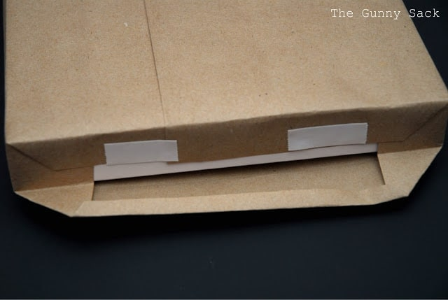 taping paper on box