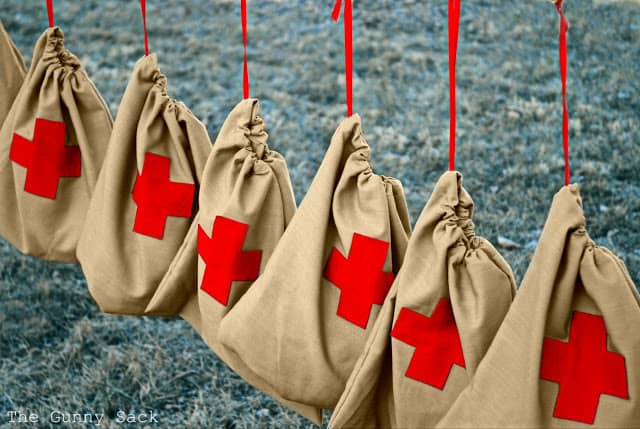 drawstring bags with red cross on them