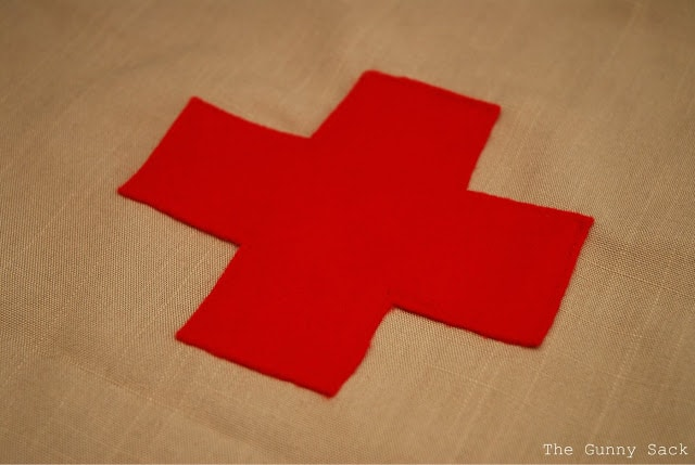red cross sewn on fabric