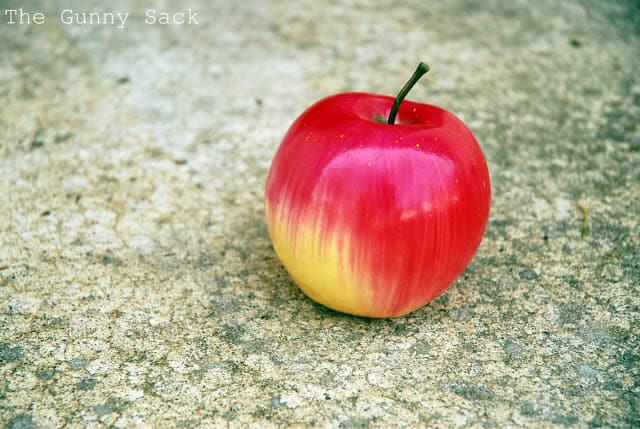 Apple With Cement Background