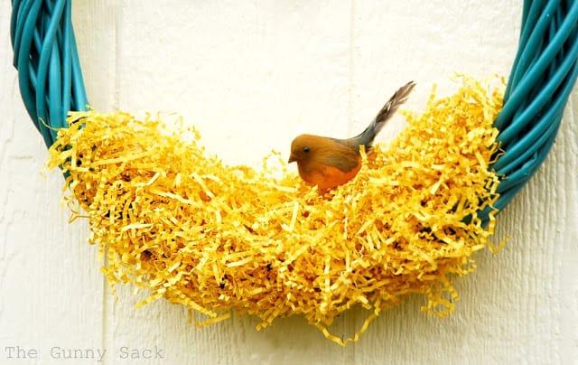 place bird on grass on wreath