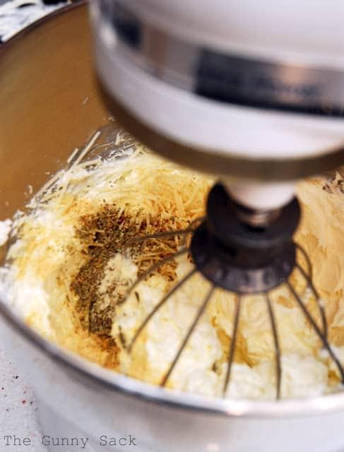 mixing garlic cheese spread