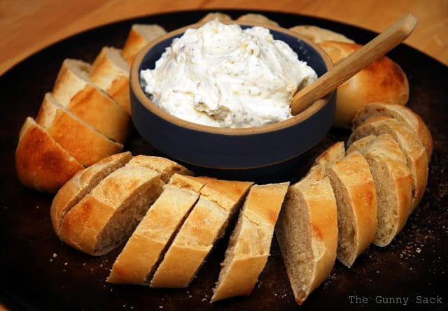sliced bread around the bowl of dip