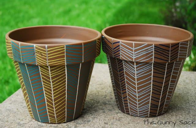 herringbone pattern on two clay pots