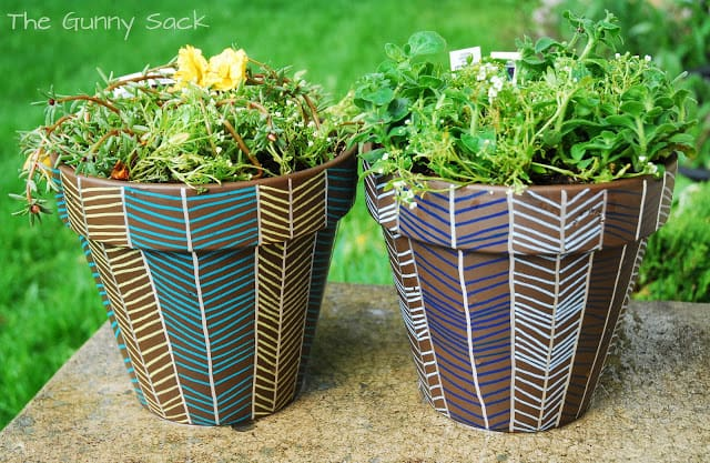 herringbone painted on two flower pots