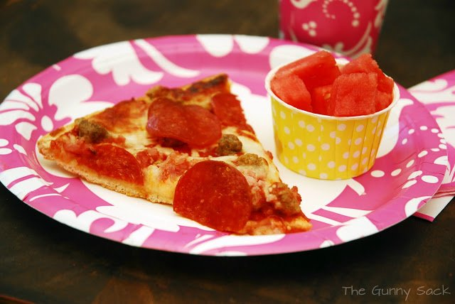 pizza and watermelon a paper plate