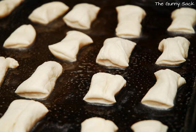 dough segments on baking sheet