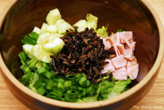 wild rice salad ingredients in bowl