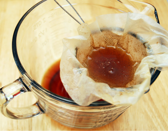 straining coffee grounds