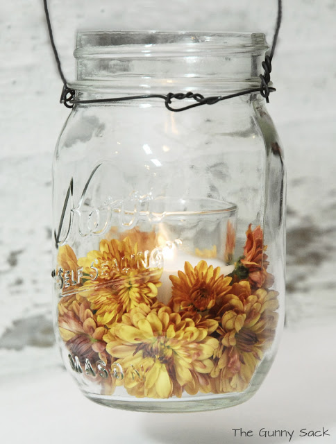 mason jar with mums and candle