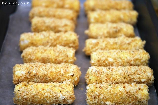 mozzarella sticks on baking sheet