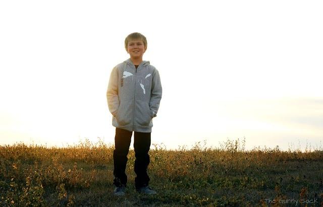 boy wearing gray hoodie