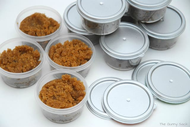 filling containers with sugar scrub