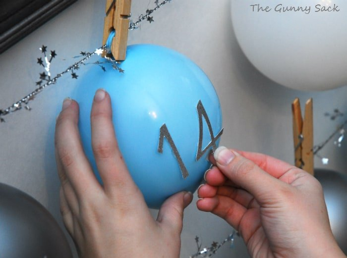 attach numbers to balloons