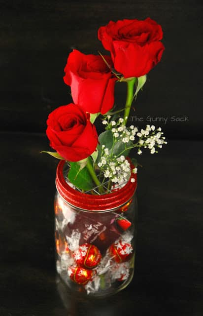 mason jar with roses and chocolate