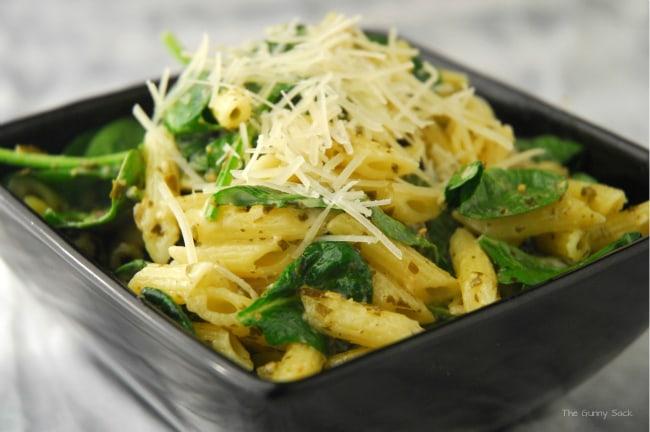 Spinach Pasta Pesto Salad in black bowl