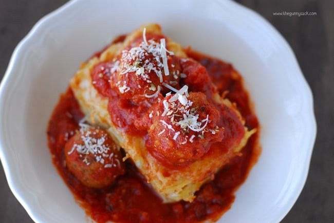 Baked Spaghetti Topped With Meatballs and Marinara Sauce