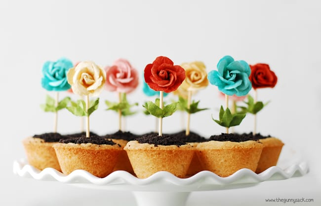 flower pot cookie cups on a white cake platter