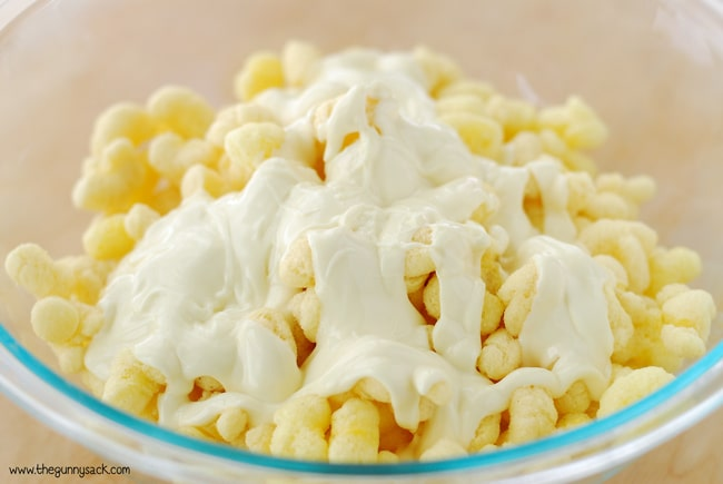 Puffcorn with melted white chocolate