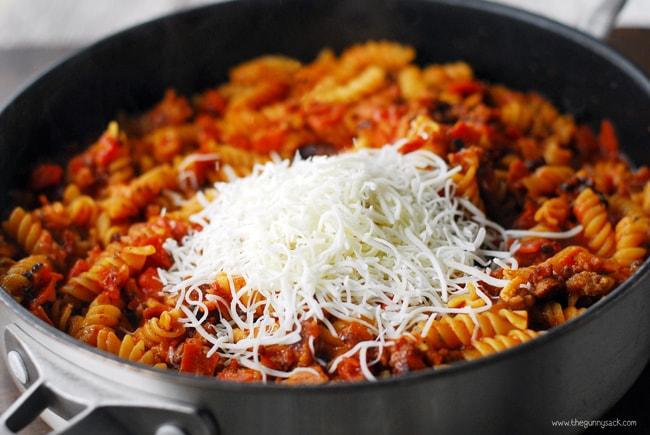 shredded mozzarella cheese on triple meat pizza casserole