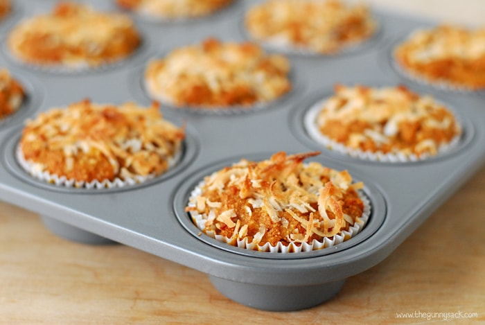 baked pina colada muffins in a muffin pan