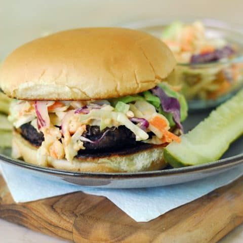 burger topped with coleslaw