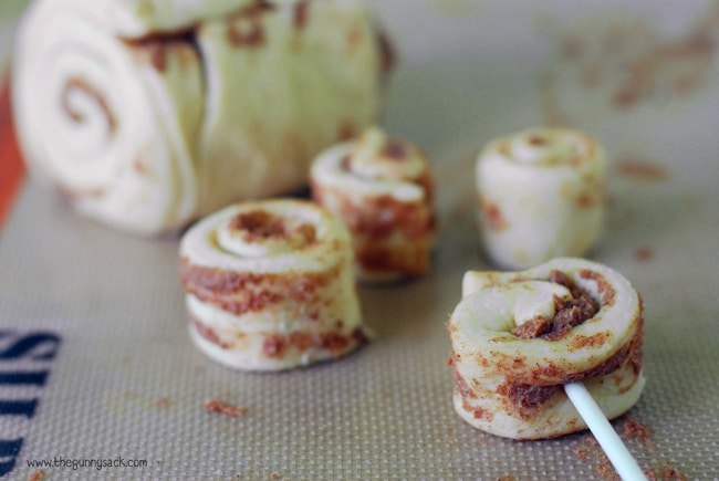 ... cinnamon roll and push a lollipop stick through the cinnamon rolls