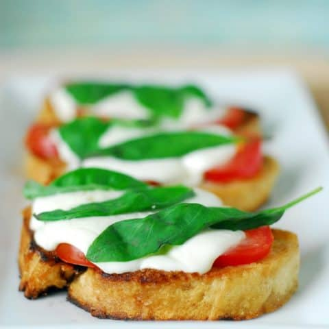 Grilled Margherita Sandwiches on a white tray