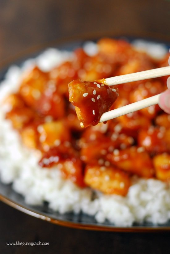 Orange chicken in chopsticks