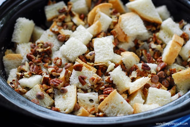 ingredients for pumpkin pecan bread pudding in a slow cooker