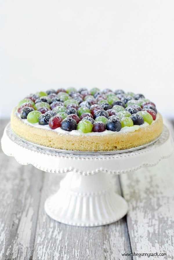triple grape fruit pizza on cake stand
