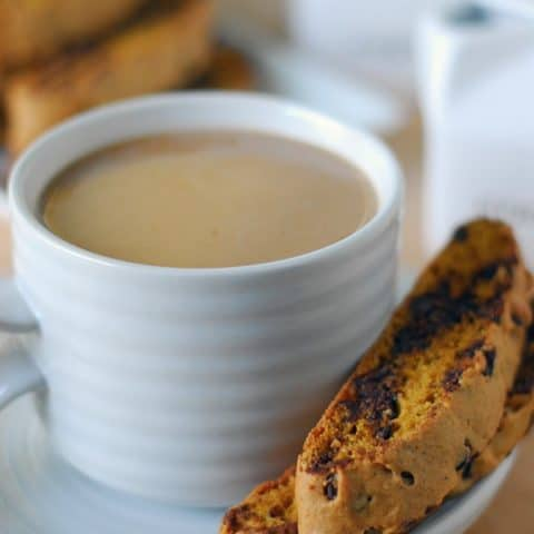 coffee in mug with two biscotti