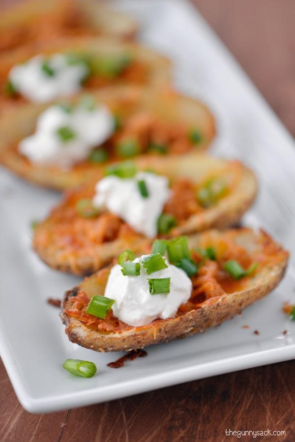 Cheesy sausage potato skins