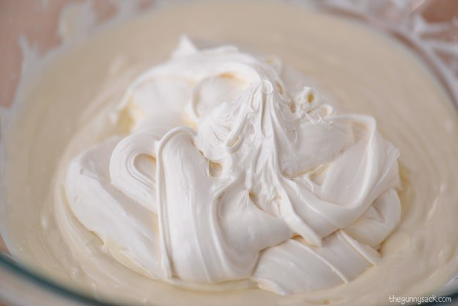 melted white chocolate added to frosting