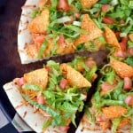 taco pizza on pizza stone from above