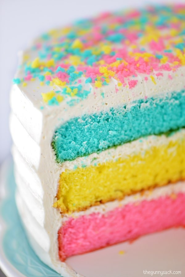 pink, yellow and blue sliced Easter cake