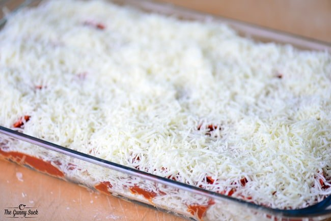top with shredded cheese
