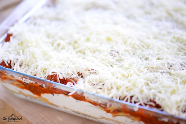 Layered Baked Spaghetti with shredded cheese