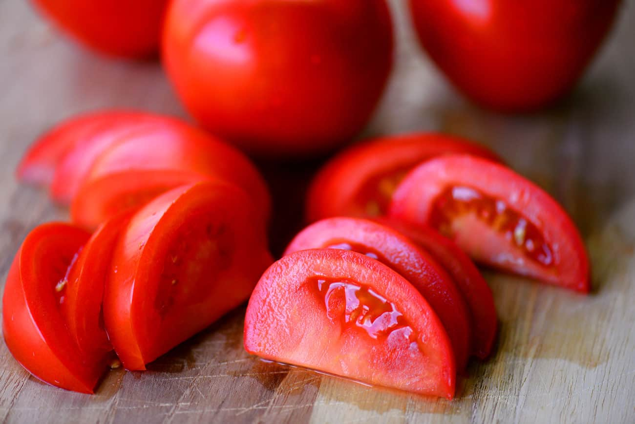 sliced tomatoes on a cutting board